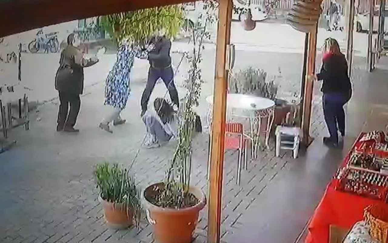 Öfkeli baba kızlarını dövmekle suçladığı kız öğrencileri kovaladı