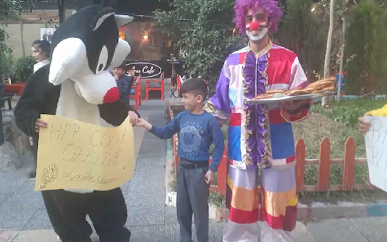 Sattığı simitleri bitiremeyen çocuğun yardımına Tweety ve Sylvester yetişti