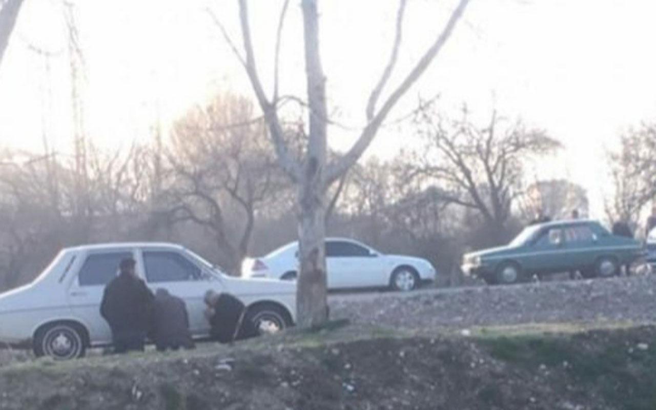 65 yaş üstü 3 kişi polise yakalanmamak için otomobilin arkasına saklandı