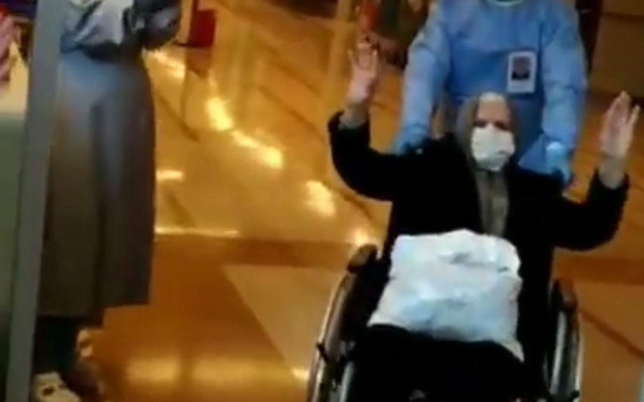 Koronavirüsü yenen 82 yaşındaki yaşlı kadın alkışlarla taburcu oldu