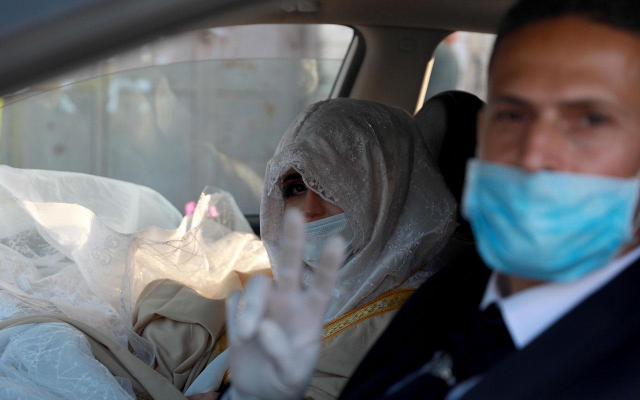 İşgal altında koronavirüse meydan okuyarak düğün yaptılar