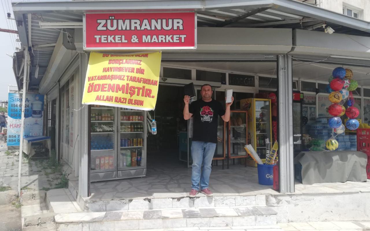 İzmir'de gizli hayırsever veresiye defterindeki 13 bin 500 liralık borcu kapattı
