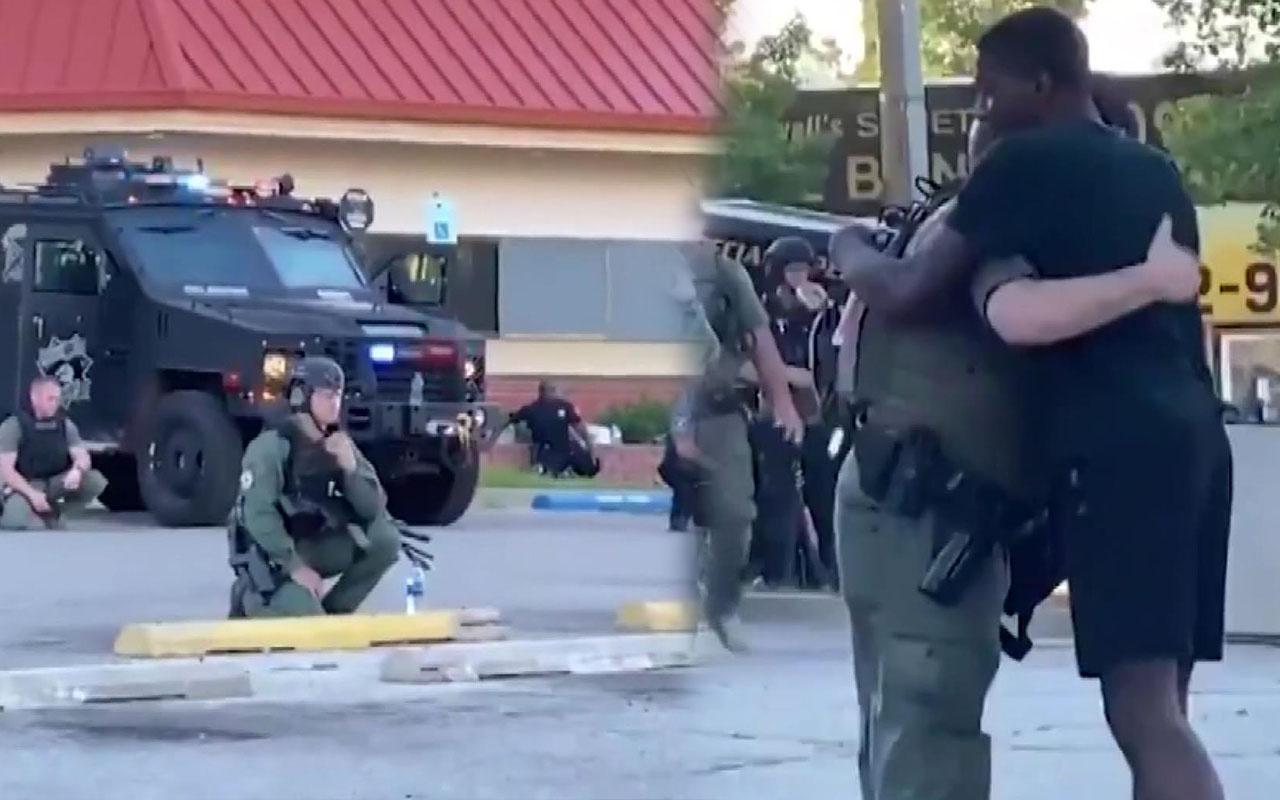 ABD'de George Floyd eylemlerinde polis protestocular karşısında diz çöktü!