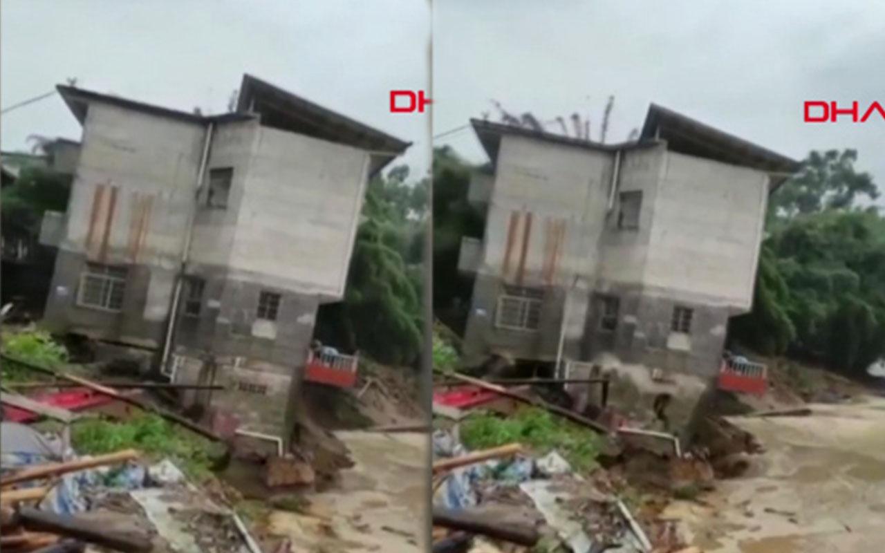 Çin'de meydana gelen selde 4 katlı ev böyle yıkıldı
