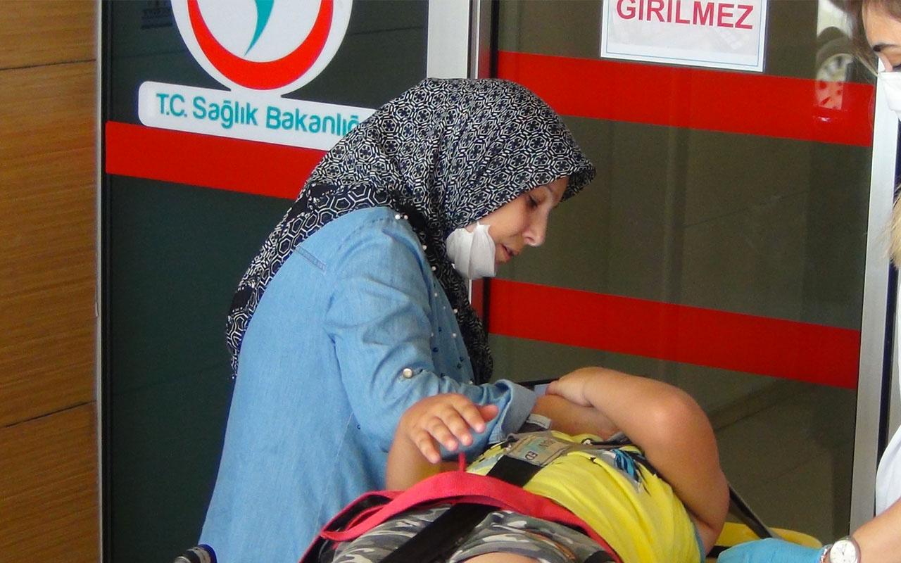 Bursa'da yaralanan oğlunu teselli eden anne kameraya yansıdı