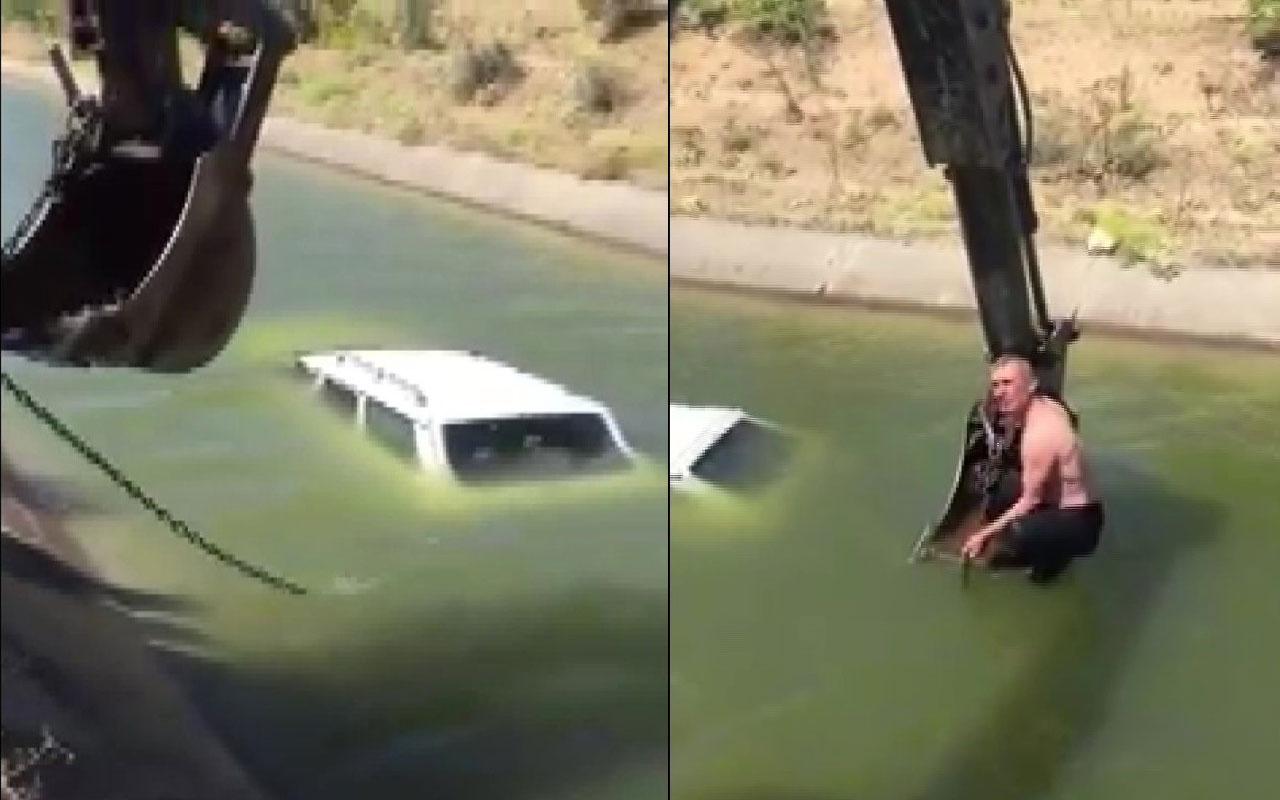 Aracıyla birlikte sulama kanalına düştü! Yardımına kepçe ile muhtar yetişti
