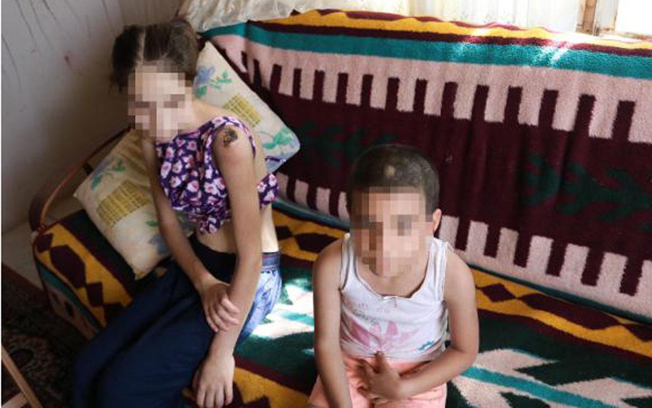 İzmir'de üvey baba vahşeti iki kardeşe keser sapıyla işkence etti tutuklandı