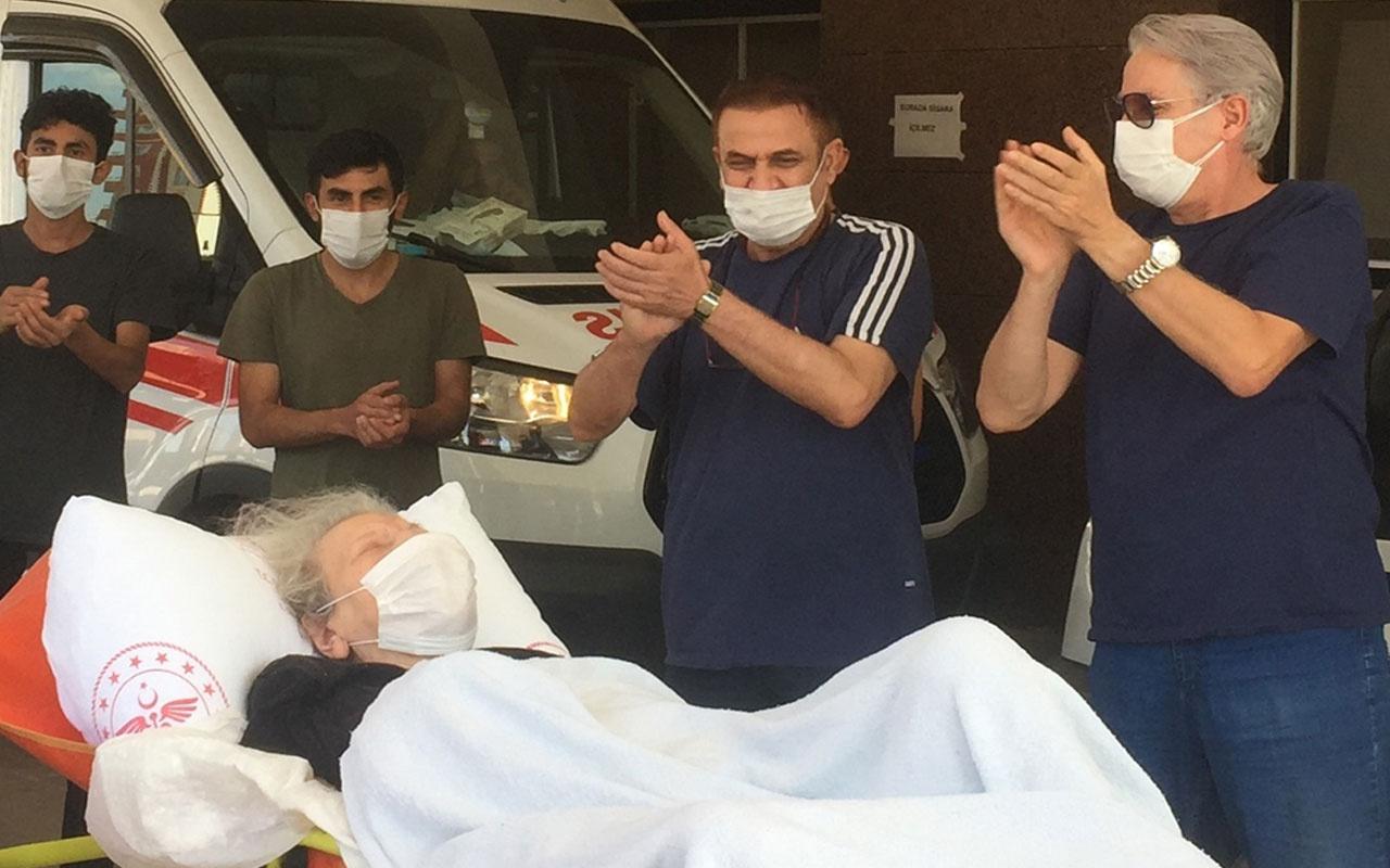 Koronavirüsü yenen 95 yaşındaki hasta alkışlarla taburcu edildi