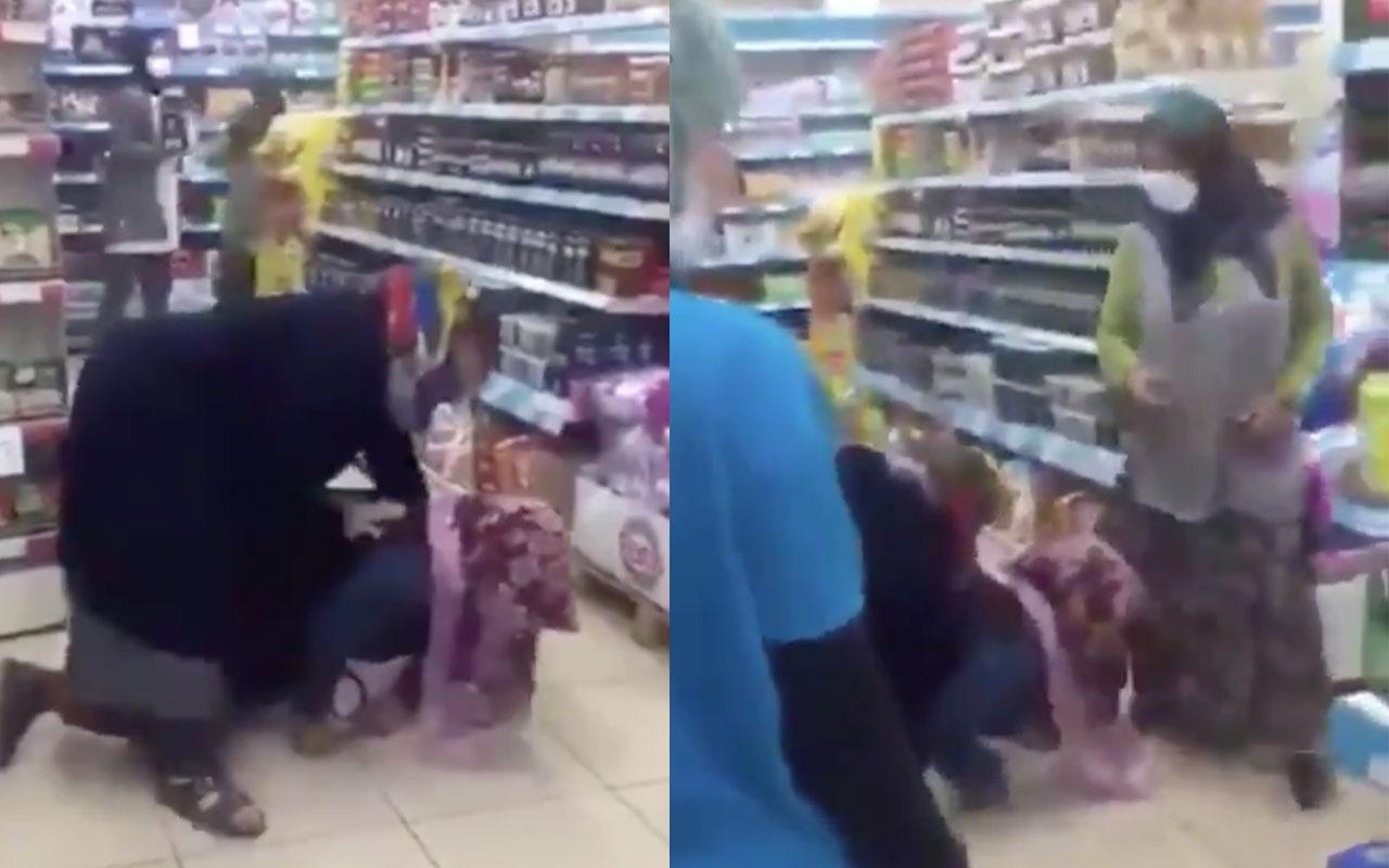 İnanılmaz anlar! Marketin ortasında kadınların düdüklü tencere güreşi