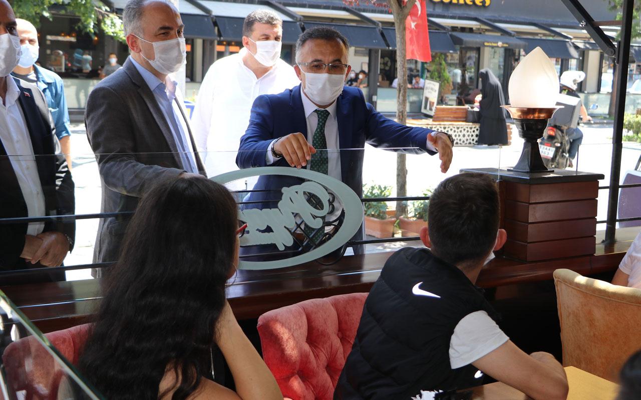 Rize'de maske ve mesafe kurallarına uymayan polislere ceza! Vali Kemal Çeber ödedi