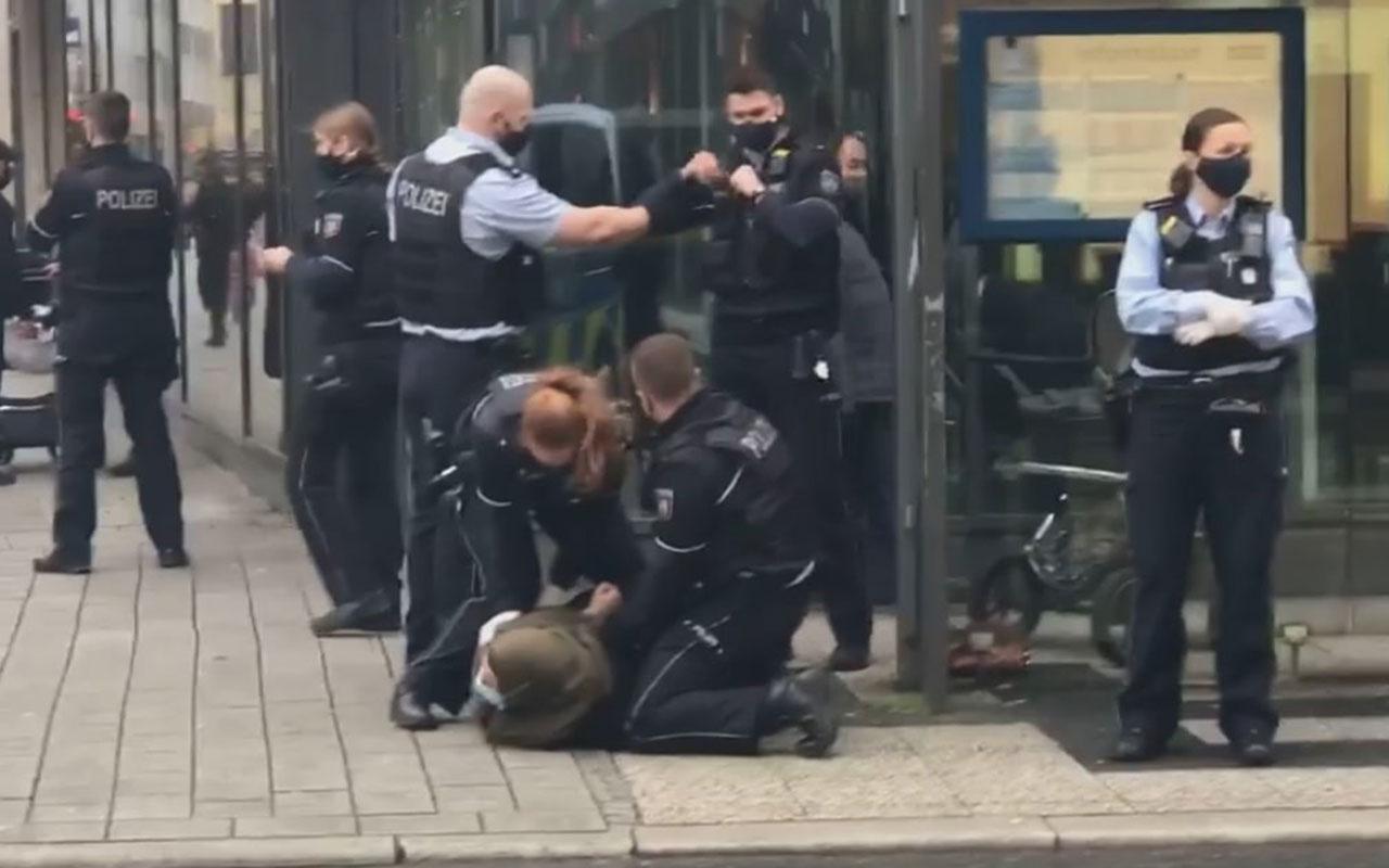 Almanya'da başörtülü kadına polis şiddeti kamerada! Tepki görünce serbest bıraktılar