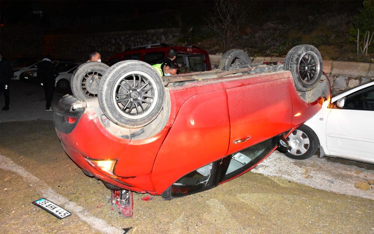 İzmir'de takla atan araç sokaktaki arabaların üzerine uçtu