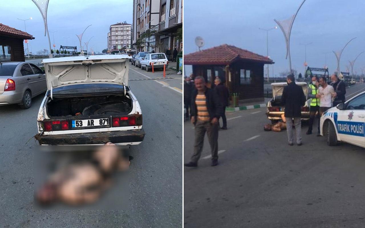Rize darp ettikleri şahsı otomobilin bagajından çıkartıp sokak ortasına atarken polise yakalandılar