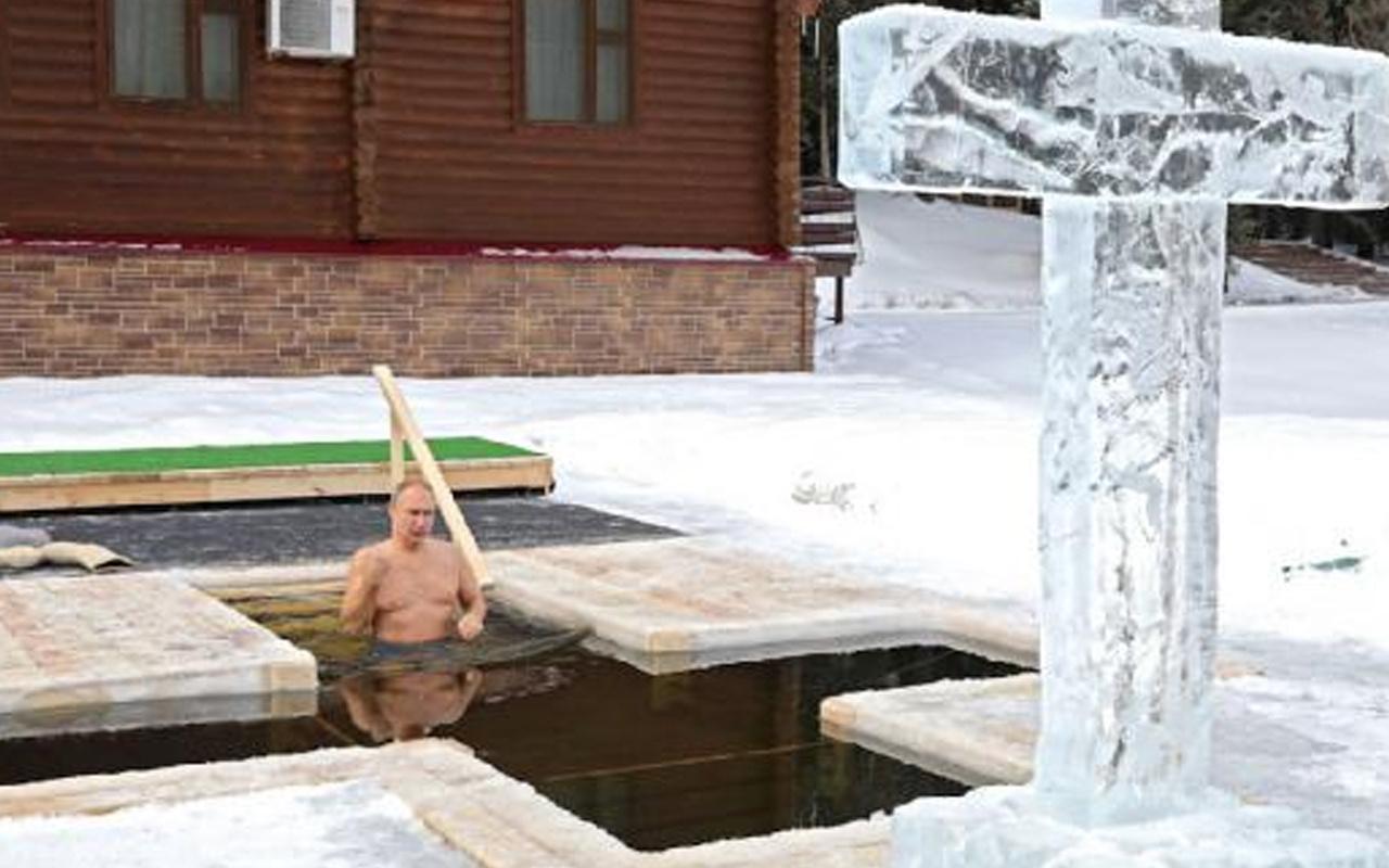 Vladimir Putin eksi 20 dereceki buzlu suya girerek Ortodoks Noelini kutladı
