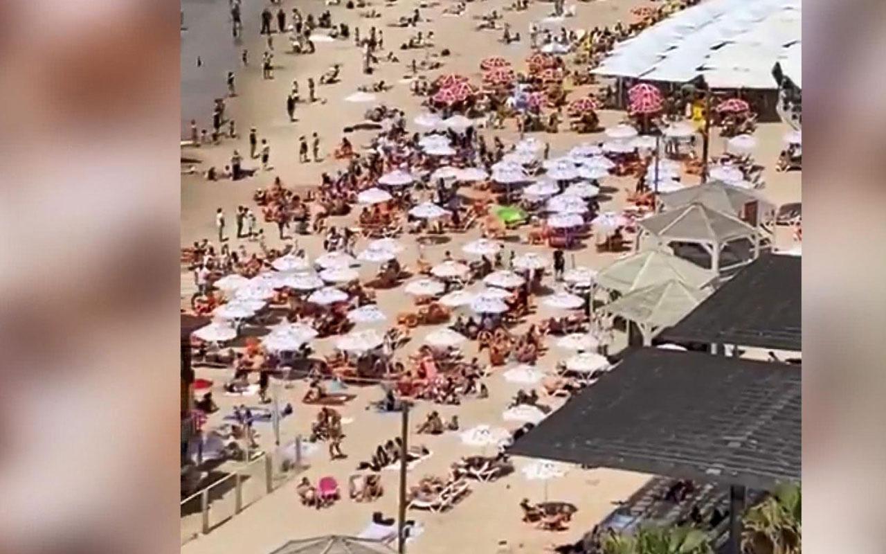 Nüfusunun tamamını aşılayan İsrail'de maske zorunluluğu kalktı plajlar doldu taştı
