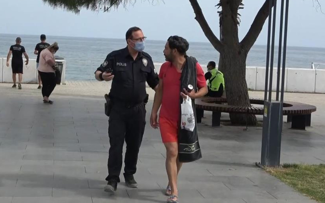 Antalya'da kısıtlamada sokakta yakalanınca ceza yazan polisleri öpmek istedi