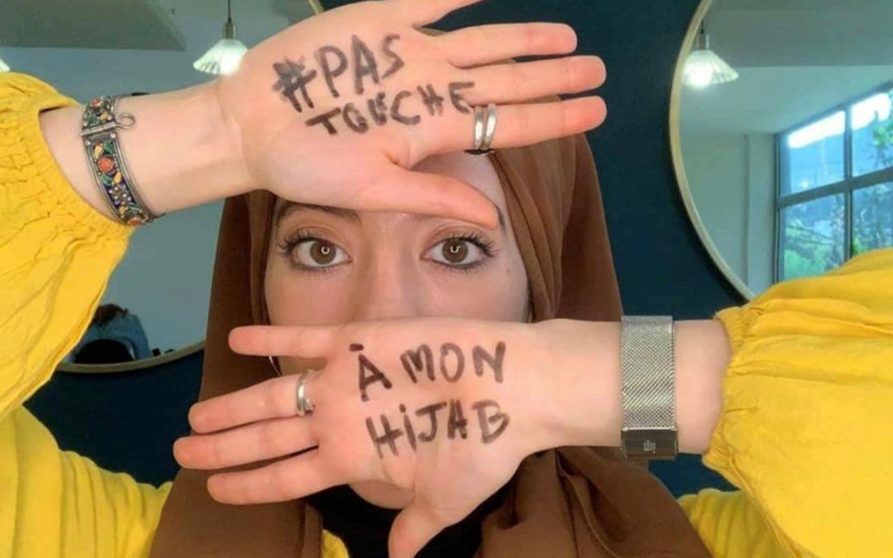 """Fransa'da Müslüman kadınlar """"Başörtüme dokunma"""" diyor"""