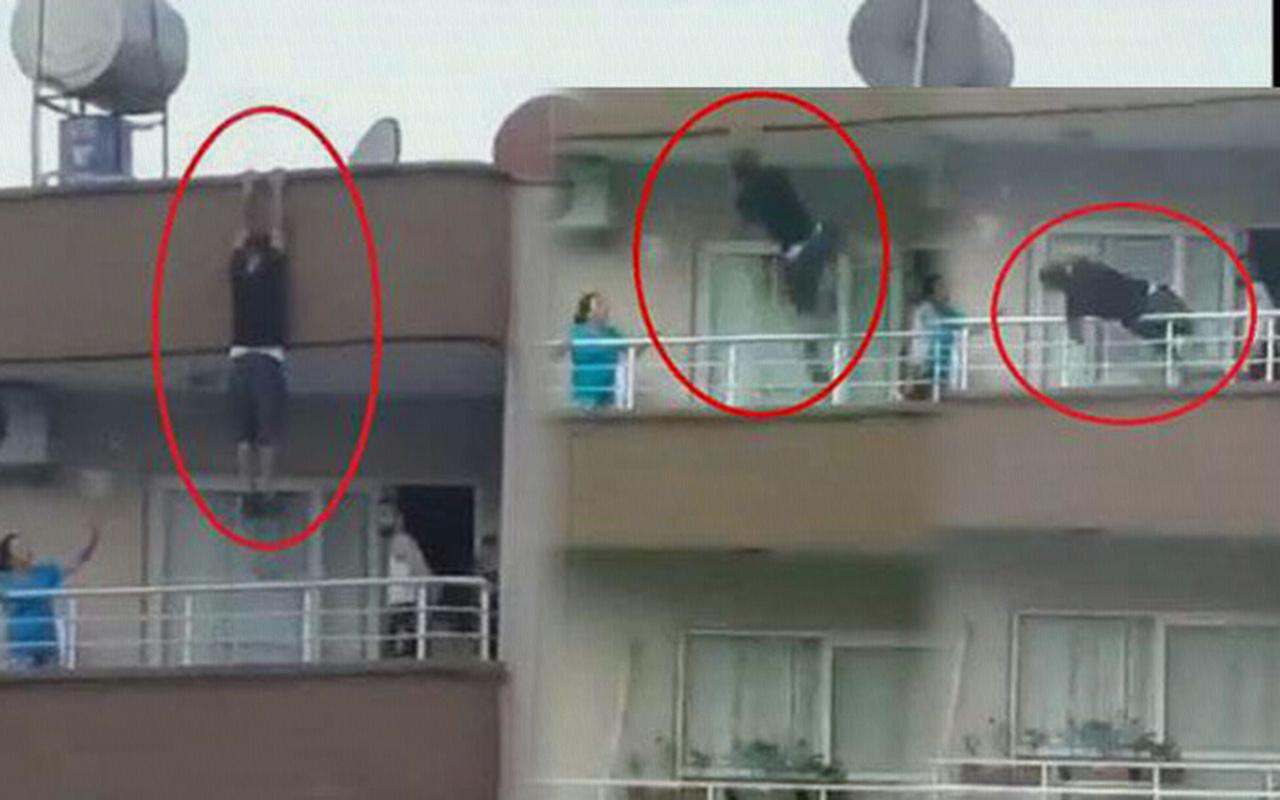 Mersin'de binanın çatısından sarkan kişi yürekleri ağza getirdi