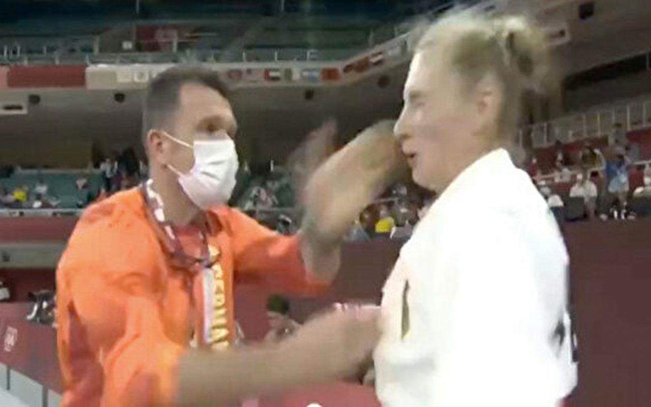 Olimpiyatlarda tokat tartışılıyor kadın sporcu antrenörüne sahip çıktı