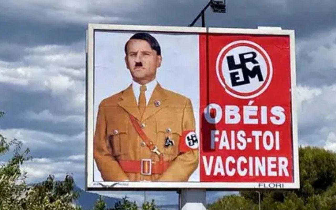 Macron'u Hitler'e benzeten afişi astı 10 bin avro para cezası verildi